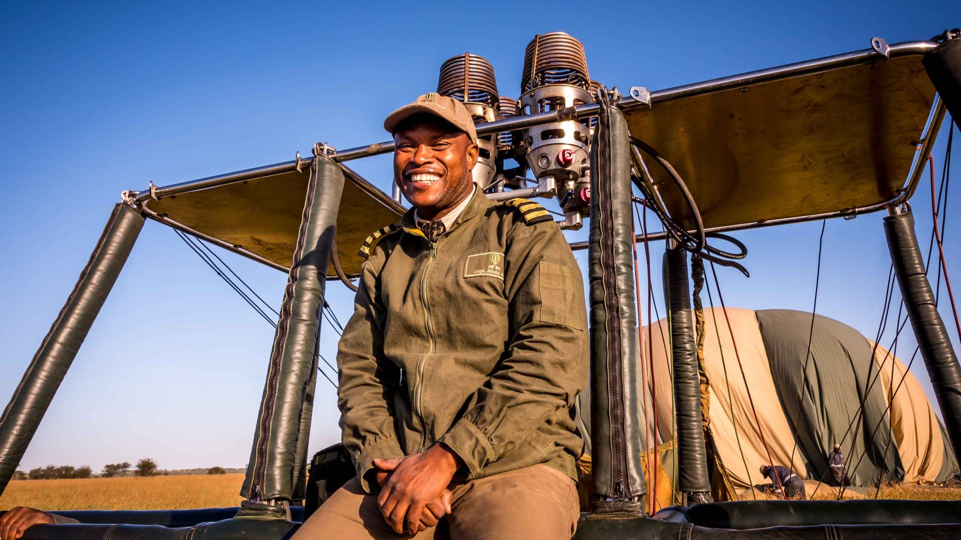 Captain Abeid Soka gives hot air ballooners a safety briefing before taking off over the Serengeti in Tanzania.