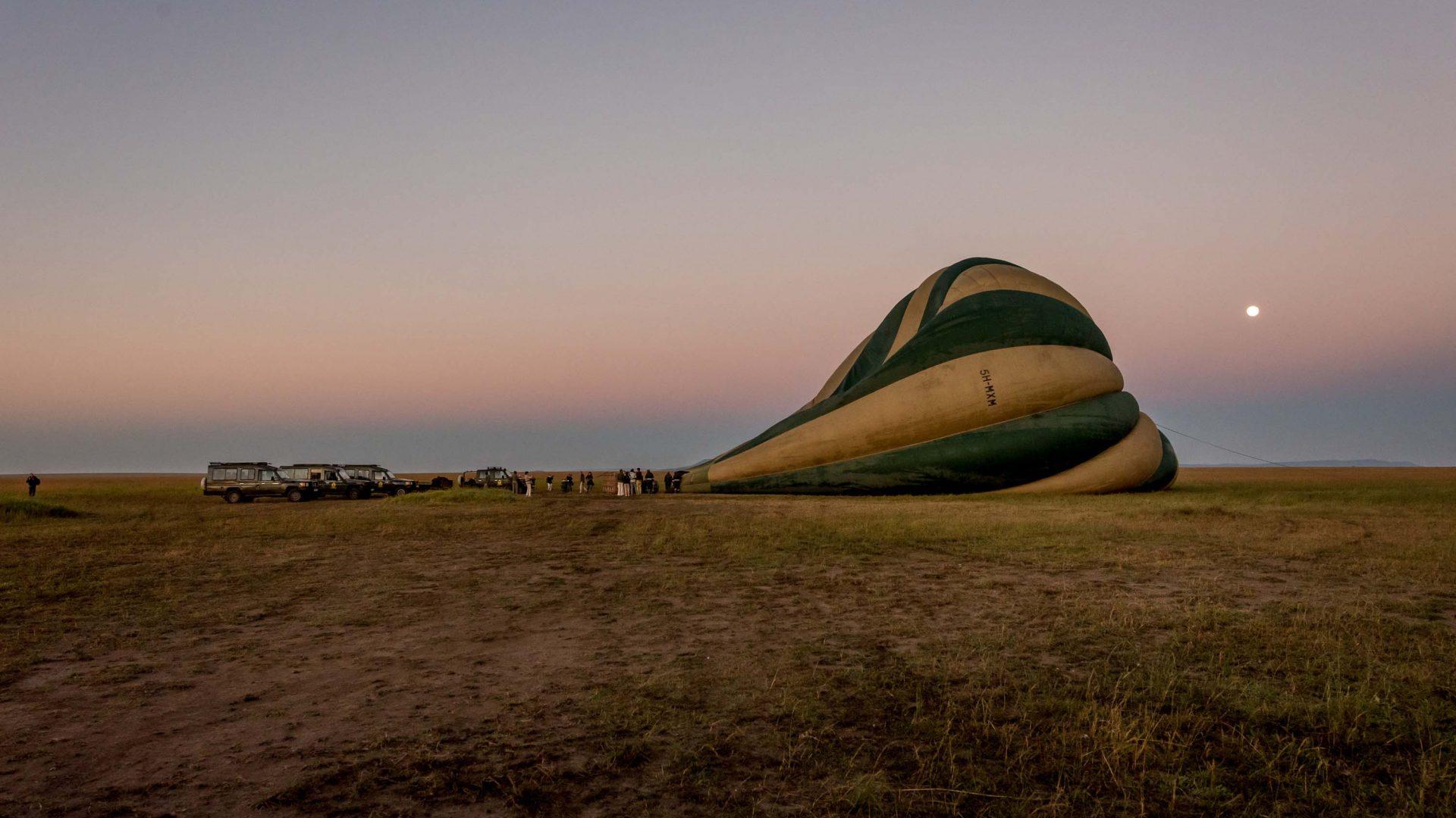 A hot air balloon gets prepared, ready to rise above the Serengeti in Tanzania.