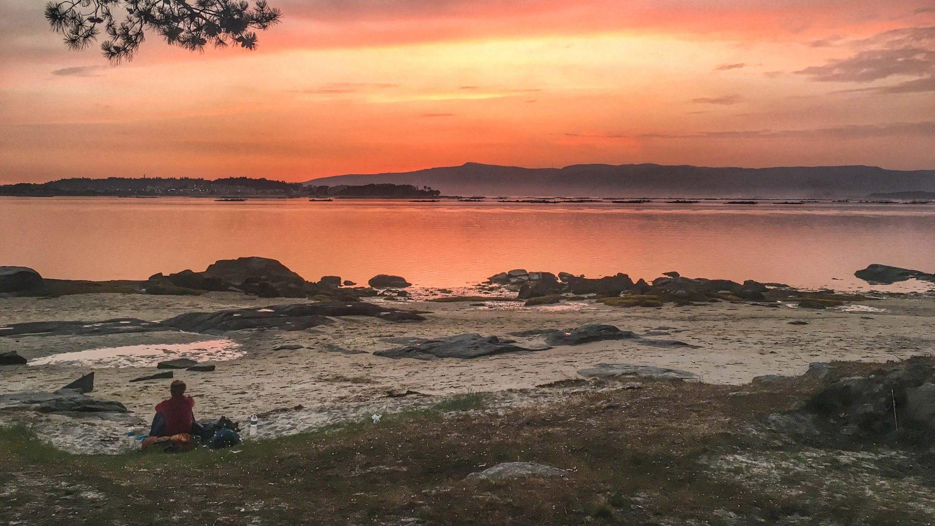 Red skies above a spot where Leon spent the night sleeping on the beach at Vilanova de Arousa, Galicia.