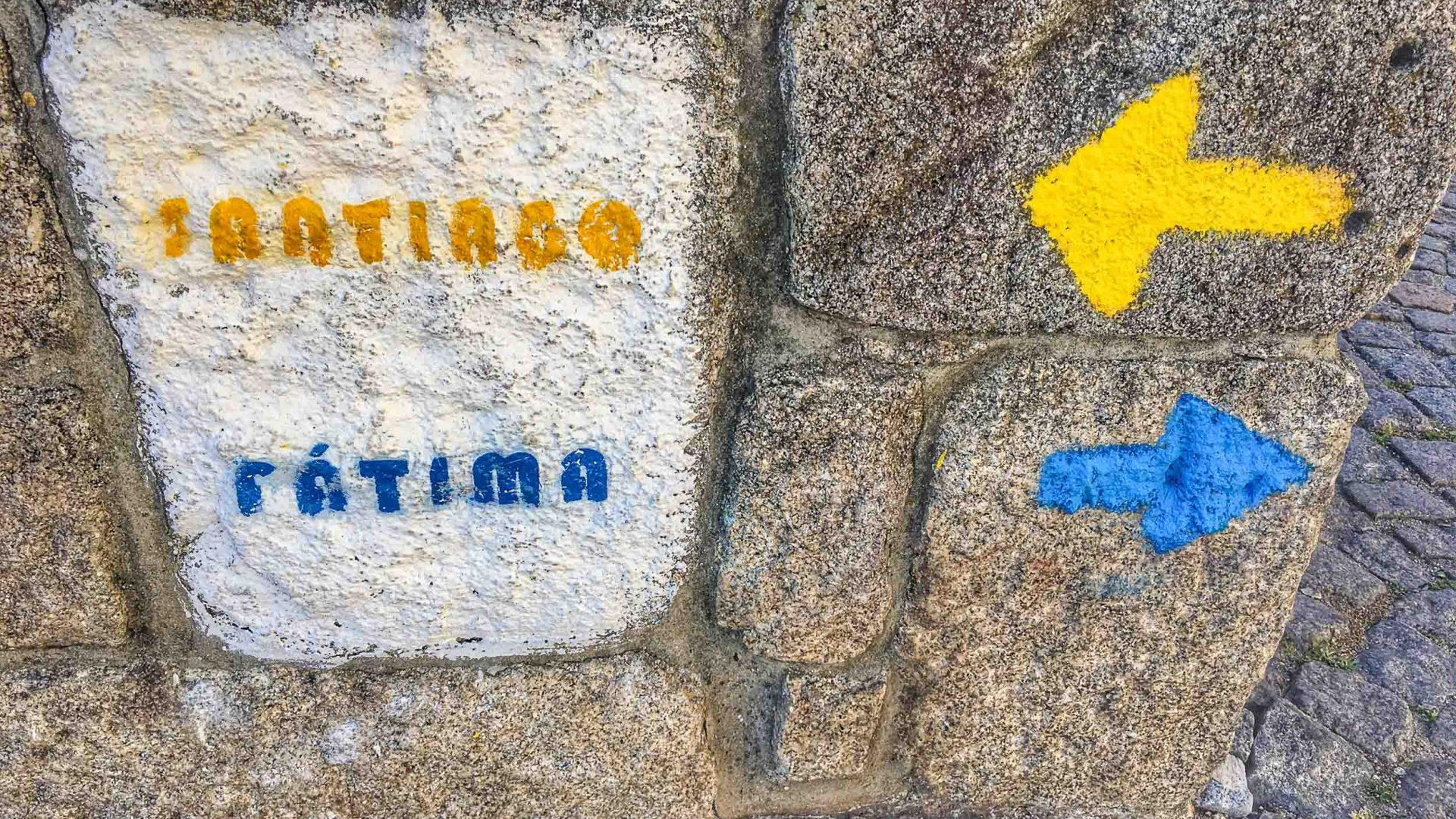 Pilgrims and hikers follow the yellow arrows to find their way to Santiago de Compostela.