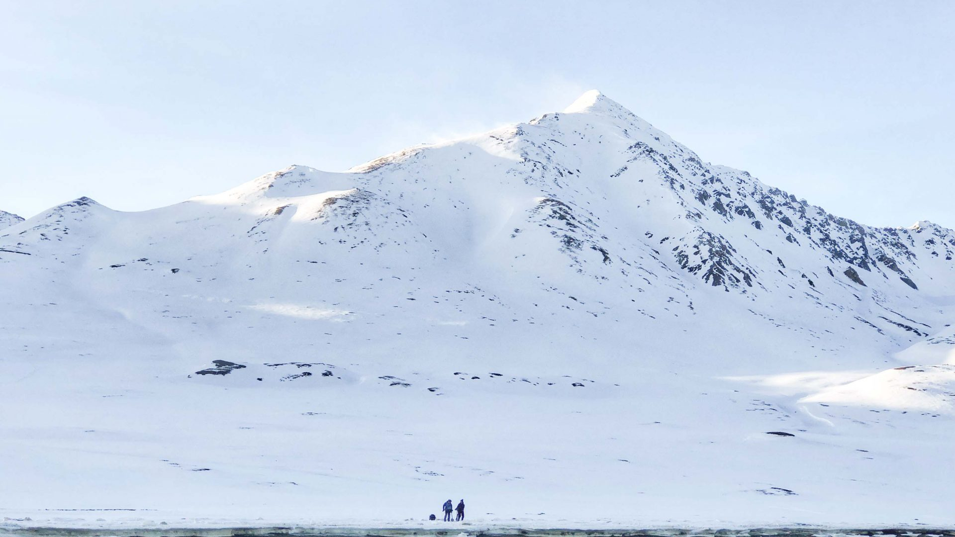Crew waiting to be picked up from a trip onto Spitsbergen island.