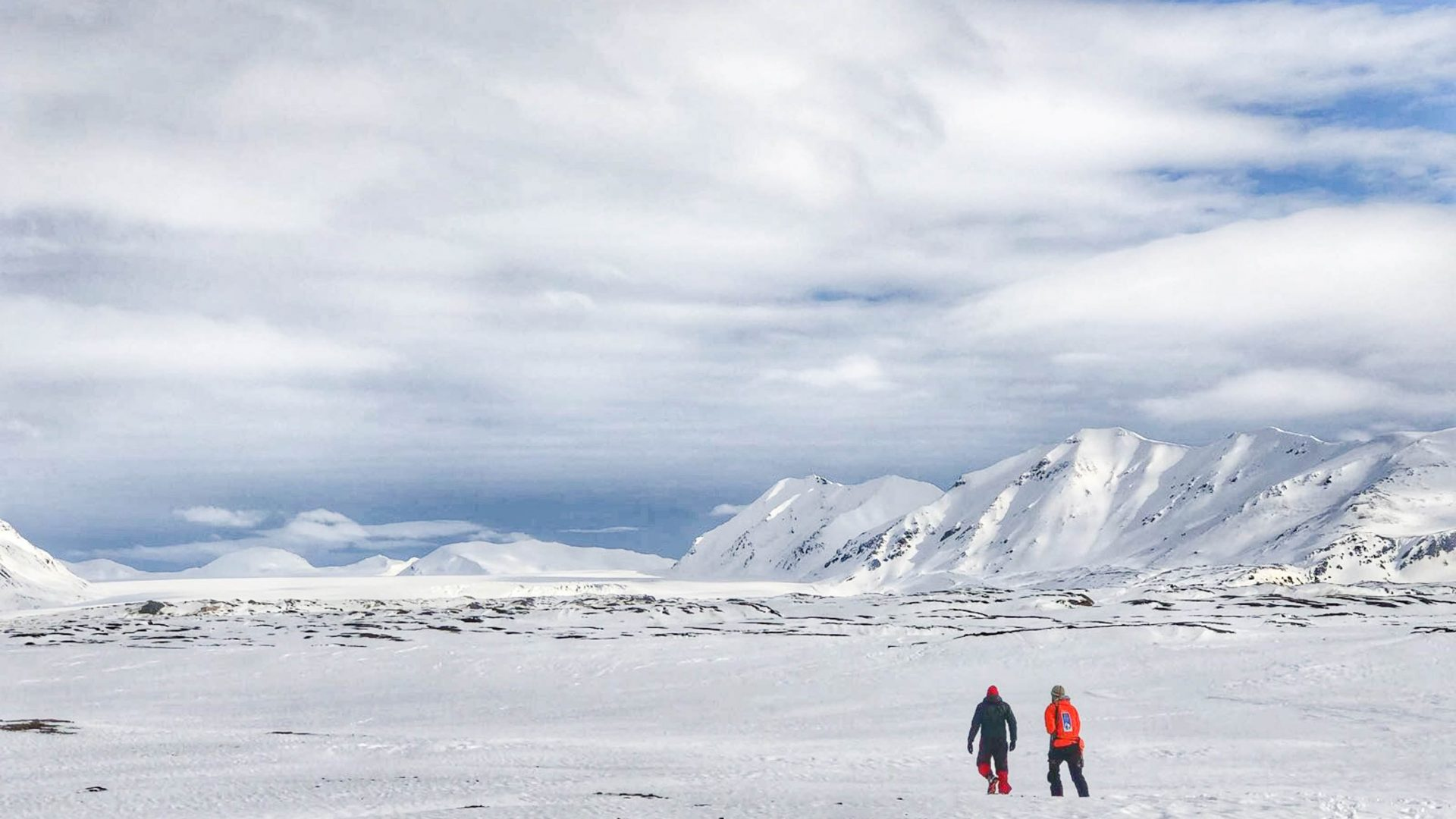 Leon and his guide Nils walking toward a glacier on the island of Spitbergen.