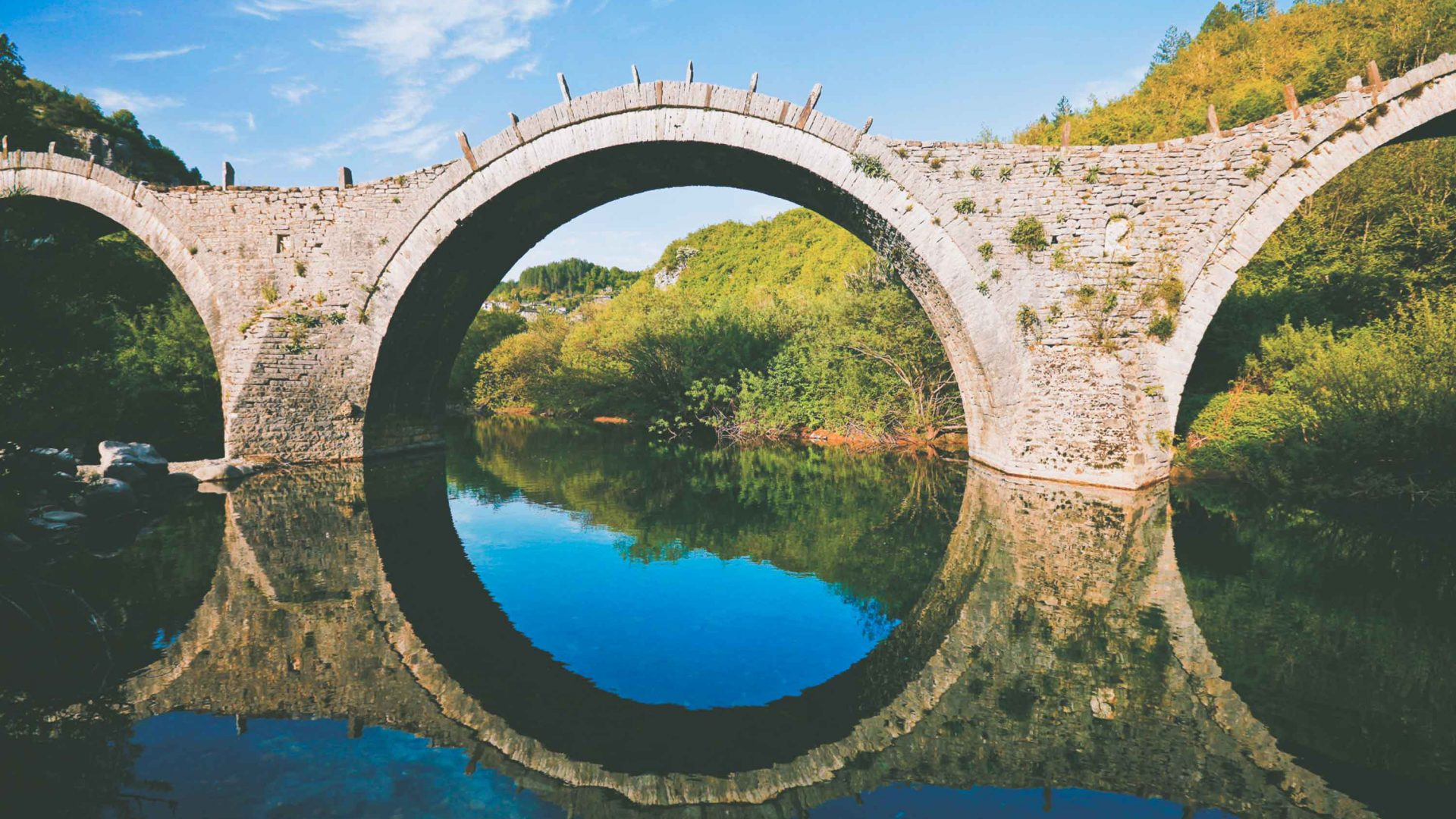 Zagori's three-arch bridge took 51 years to build since the river washed it away every winter.
