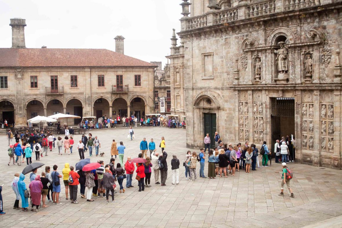 Hikers and pilgrims line up to visit the Camino's holy grail: The cathedral of Santiago de Compostela, Spain.