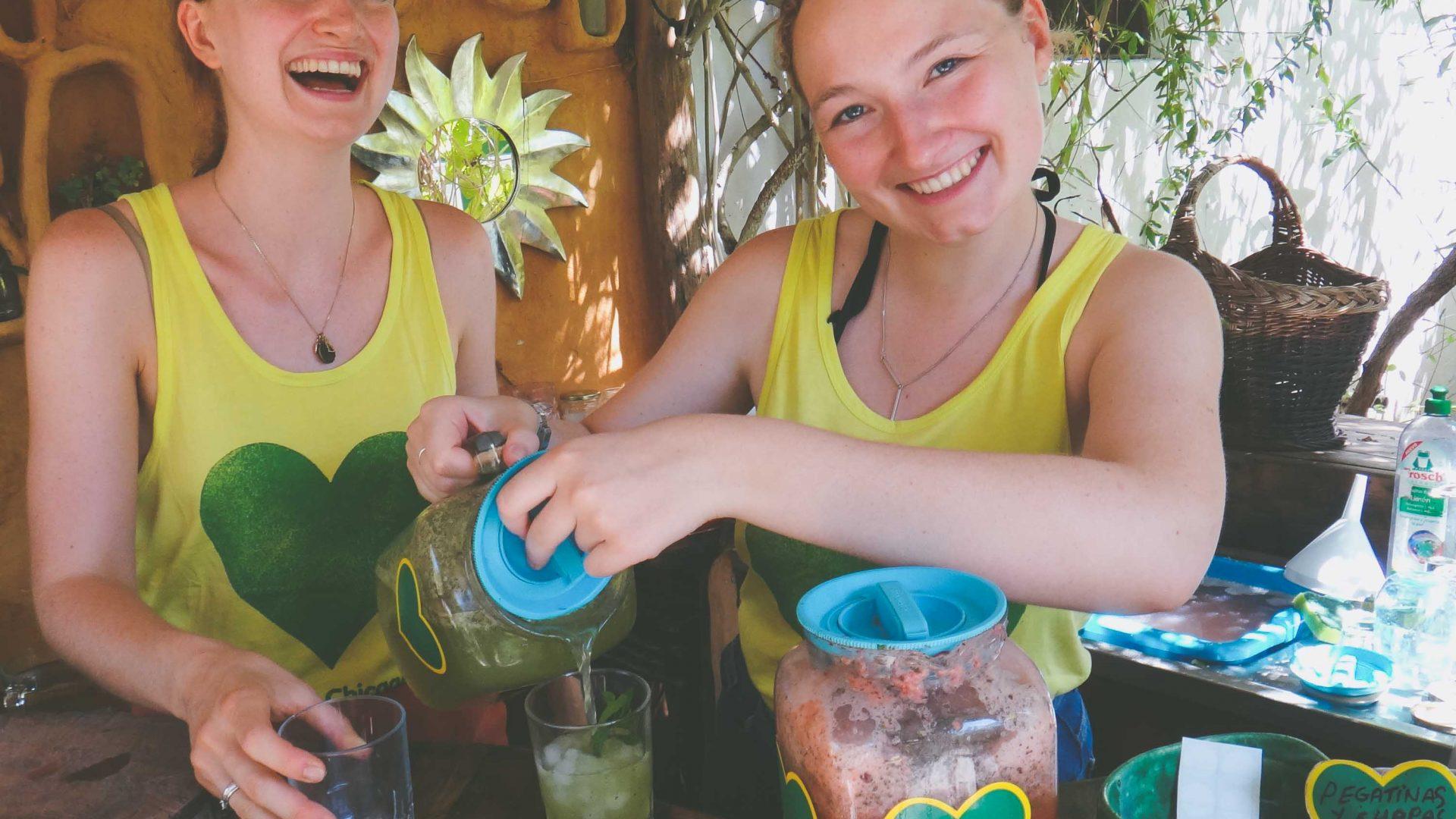 Volunteers prepare fresh juice using vegetables grown at Casita Verde.