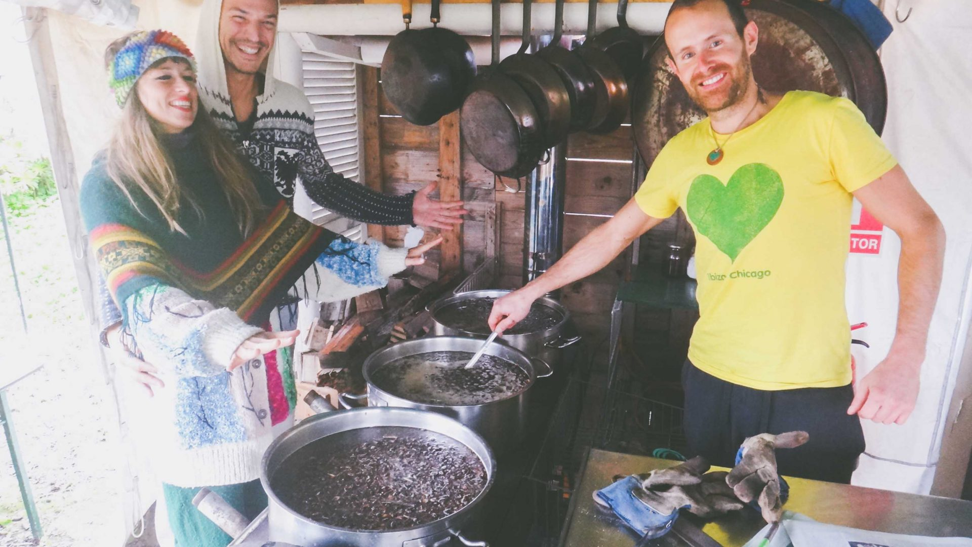 Cooking local carobs on a wood-burning stove to make Casita Verde's famous syrup.