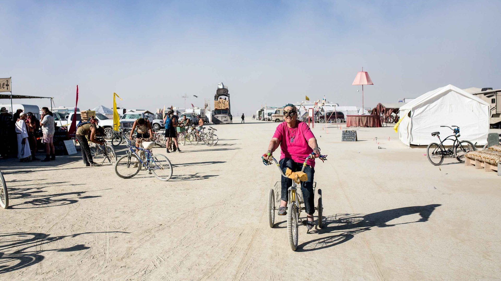 Carolyn Monroe, 81, getting around on her tricycle at Burning Man.