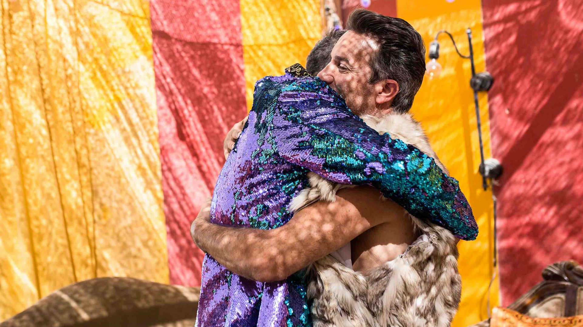 Gordon Farber hugs his brother Rowan Farber at their camp at Burning Man.