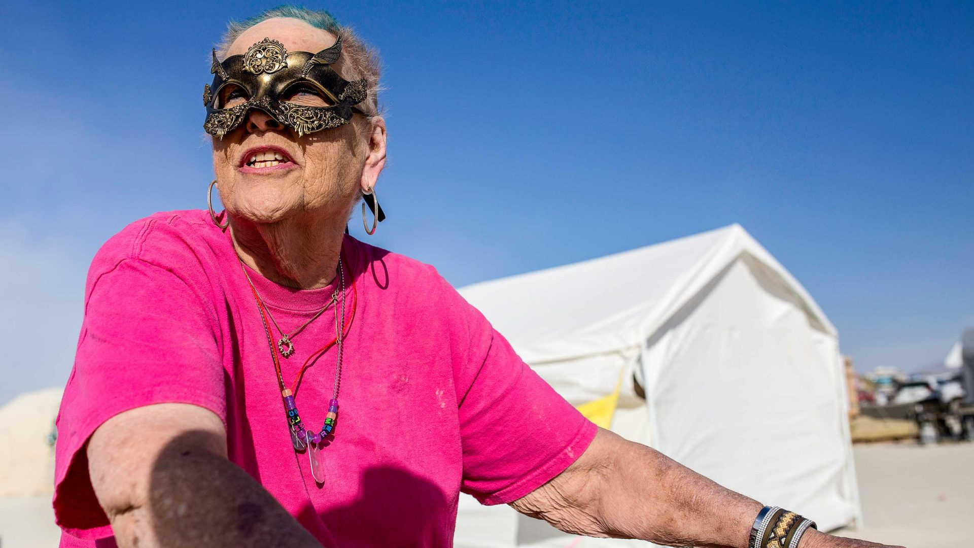 Carolyn Monroe, 81, on her tricycle at Burning Man.
