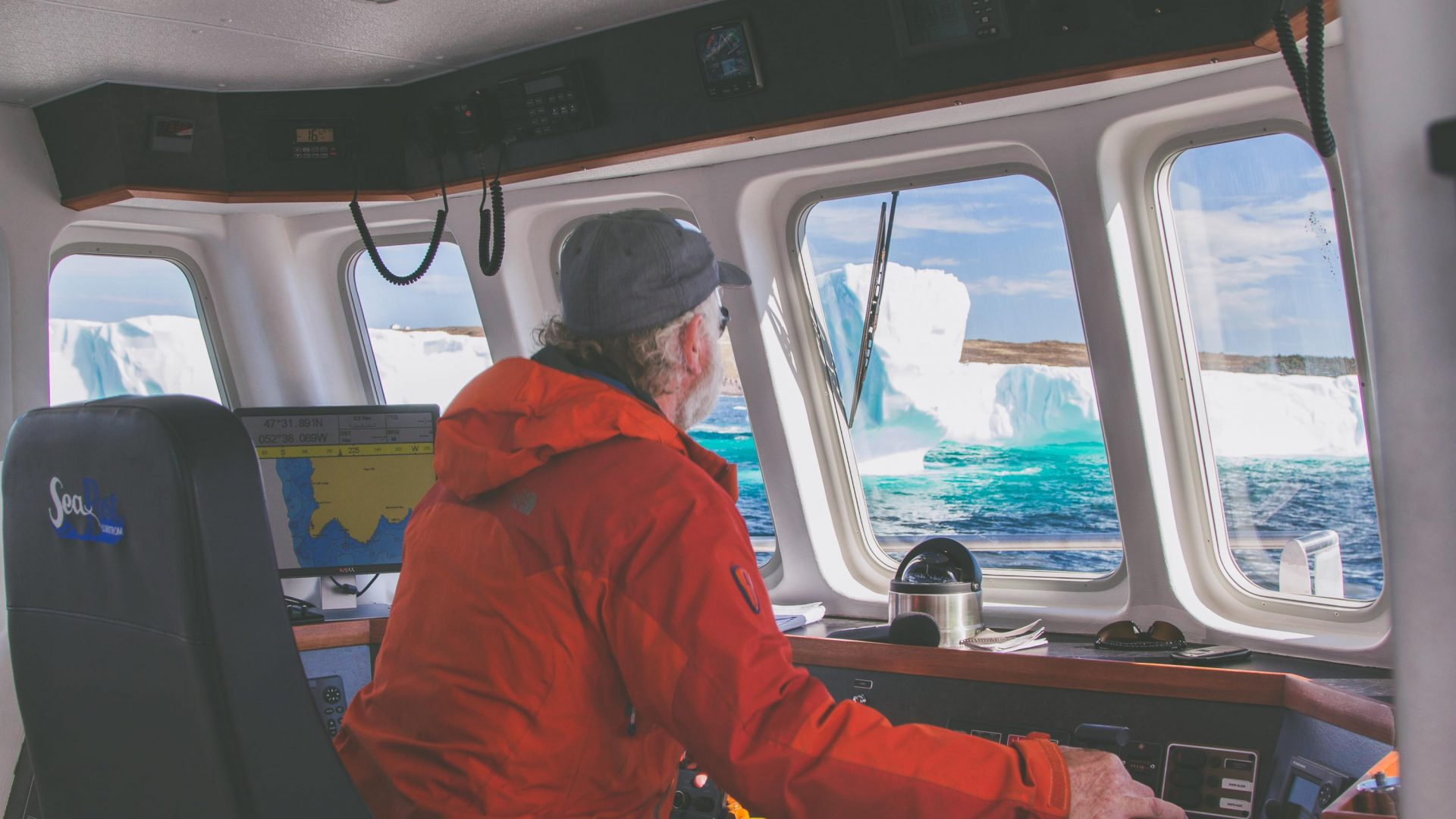 Captain Barry Rogers maneuvers Iceberg Quest through the waters of Newfoundland.