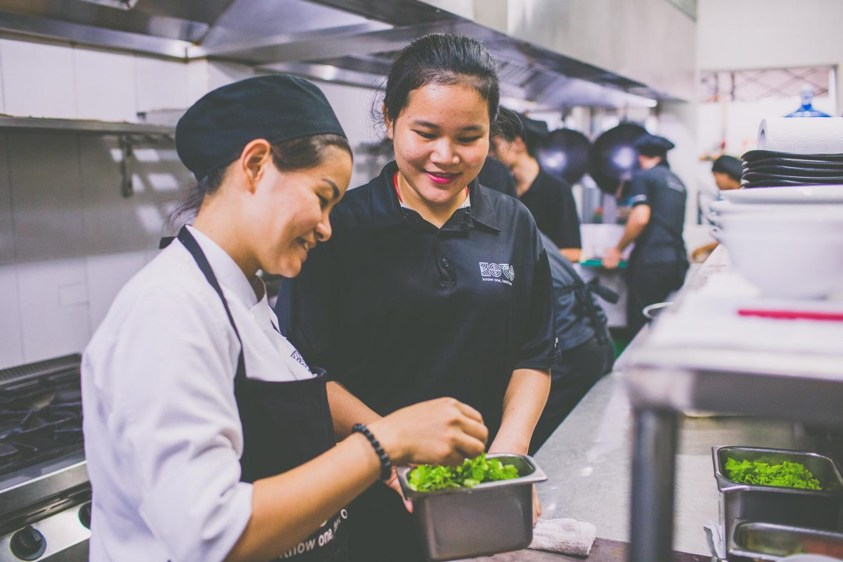 Class 34 trainee, 18-year-old Kieu, is trained by a chef in the restaurant.