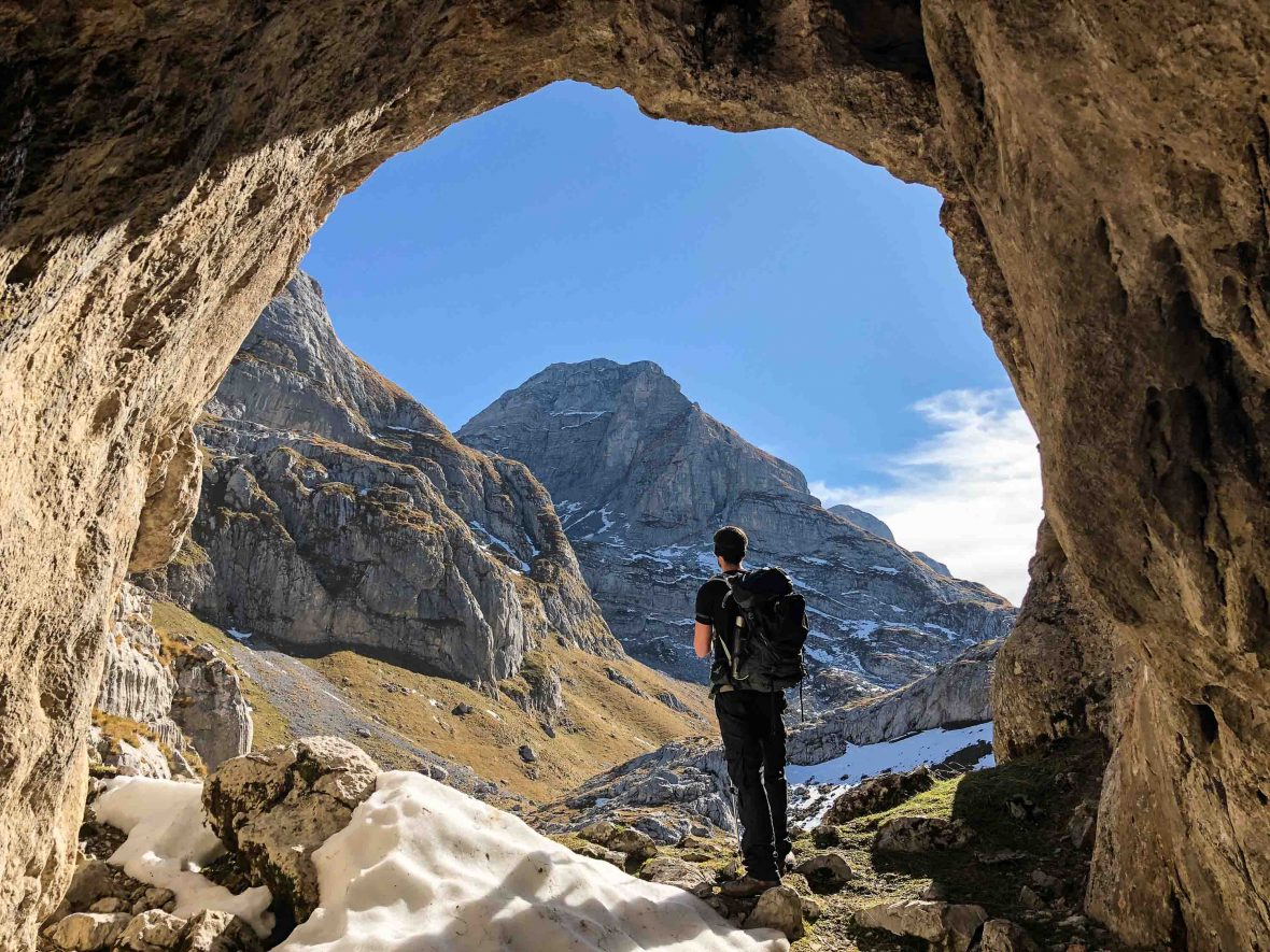 A cave looking out to Maja Kolata, the highest mountain in Montenegro.