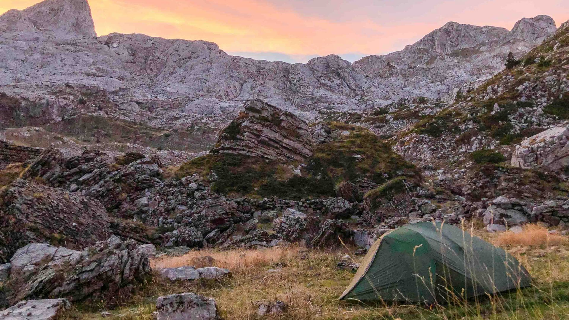 Sunset in the mountains, with Leon's tent nestled peacefully beneath the rocks.