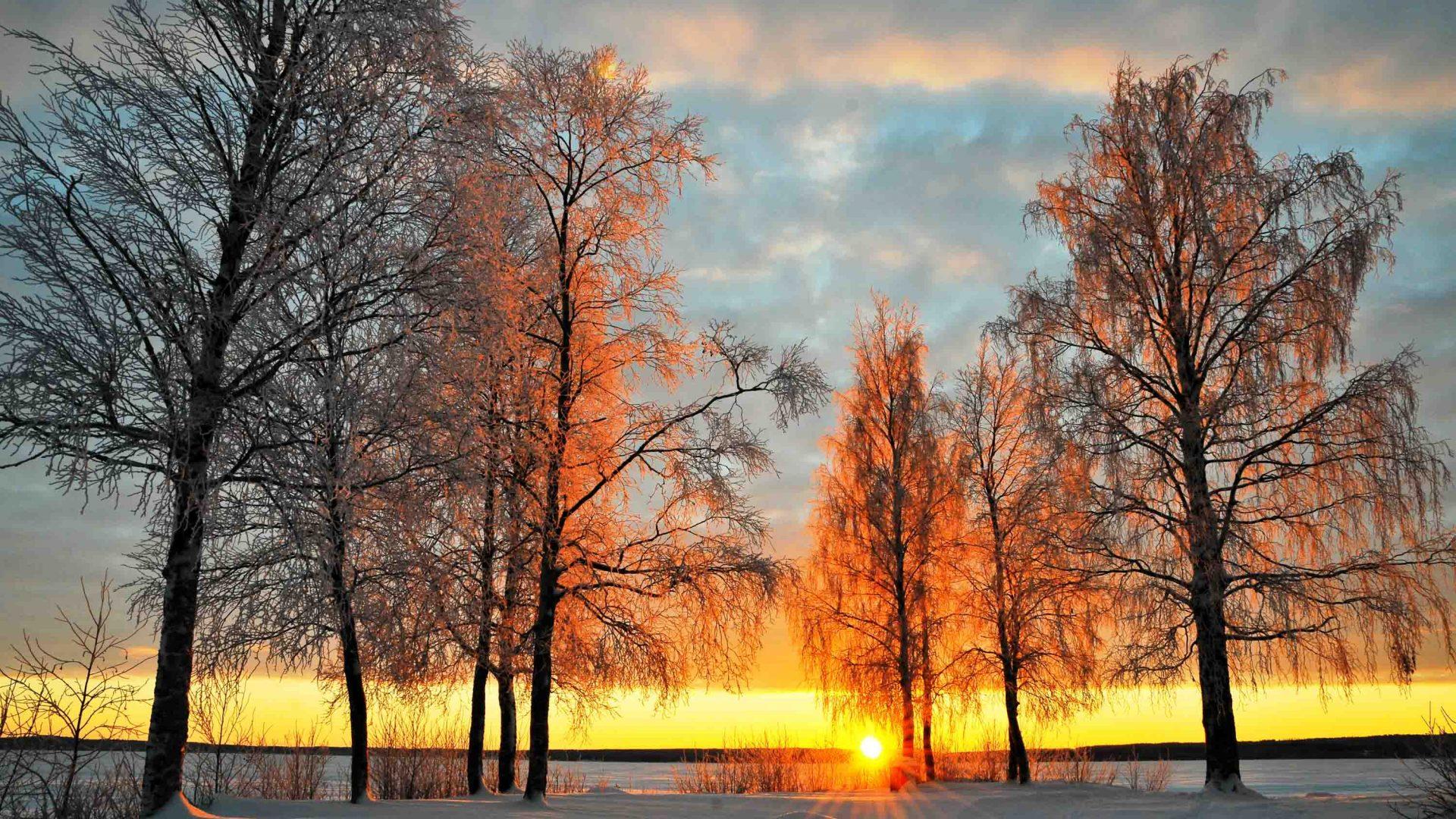 The sun sets in the small village of Jukkasjärvi, Sweden's northernmost town.