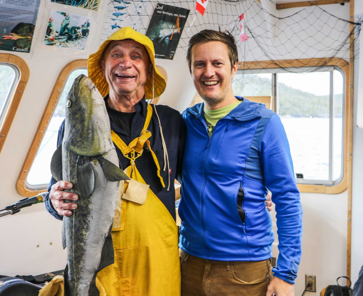 Writer Mike MacEacheran with Captain Reg Williams and a frozen cod.