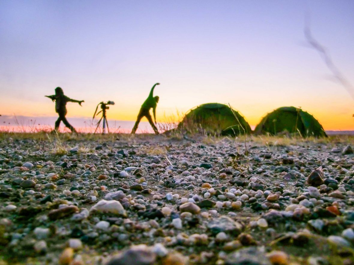 Stretching at the end of a day in the Gobi Desert.