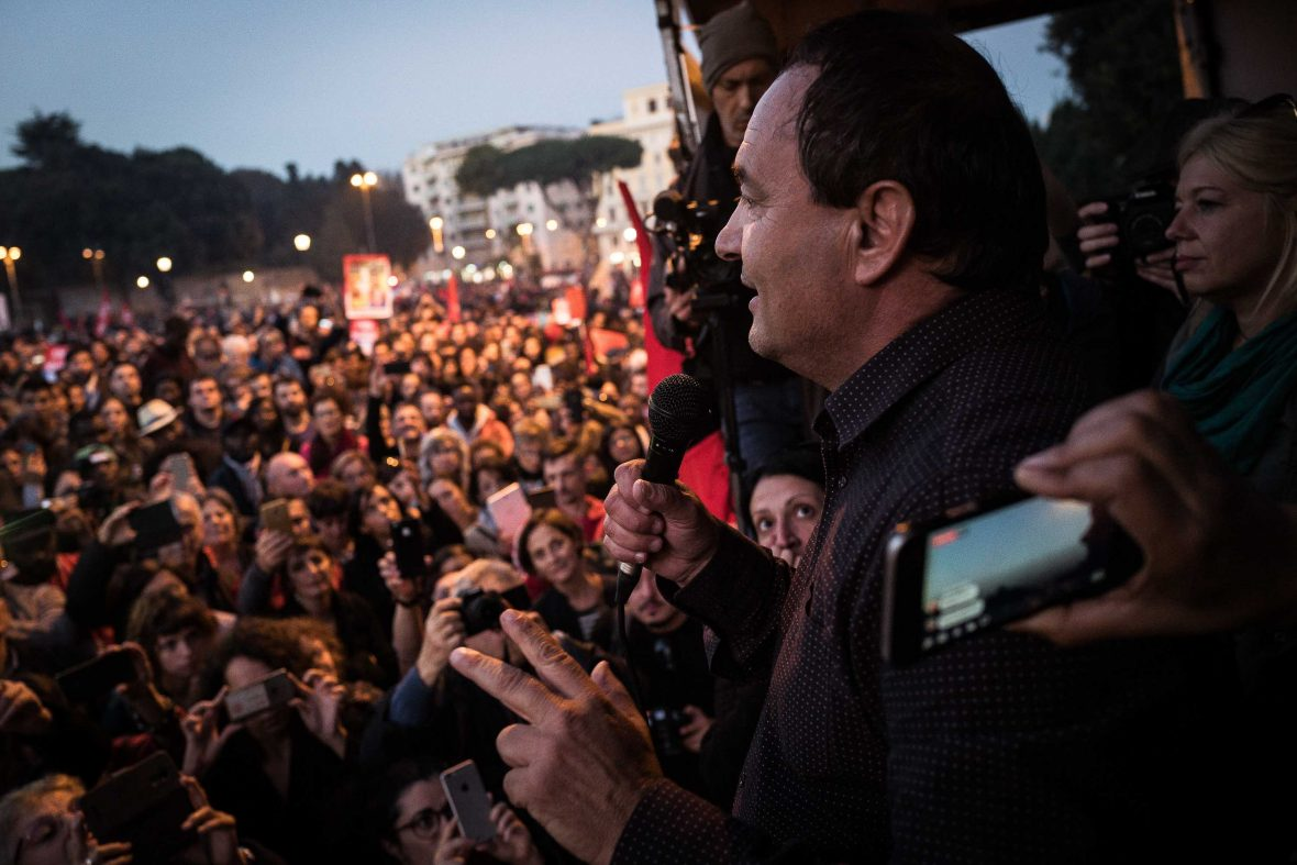 Domenico Lucano looks out over his supporters in Riace.
