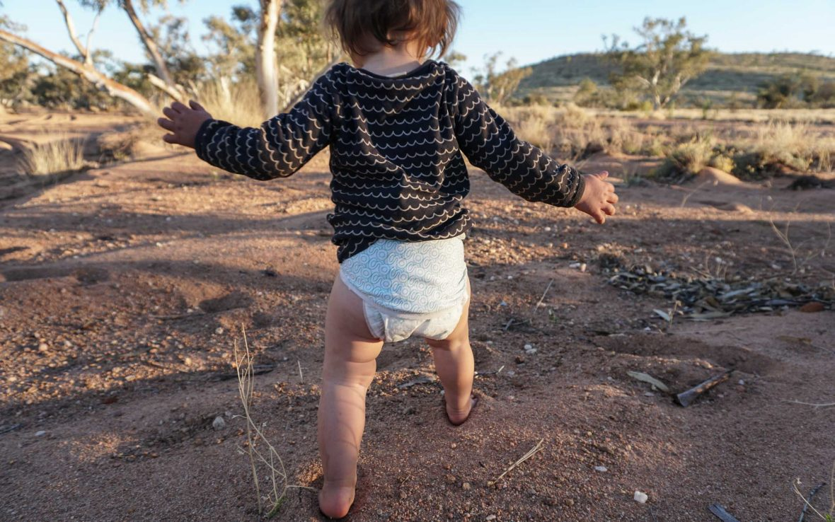 15-month-old Morgan Jones finds her feet in the Outback.