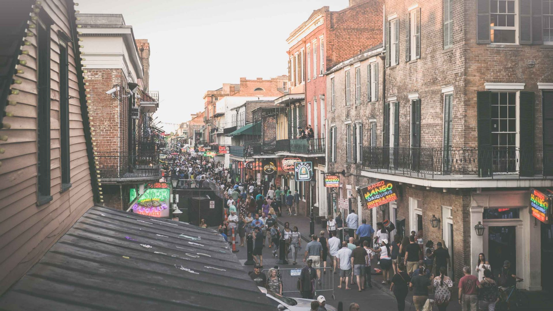 Crowds flock to Bourbon Street, New Orleans.