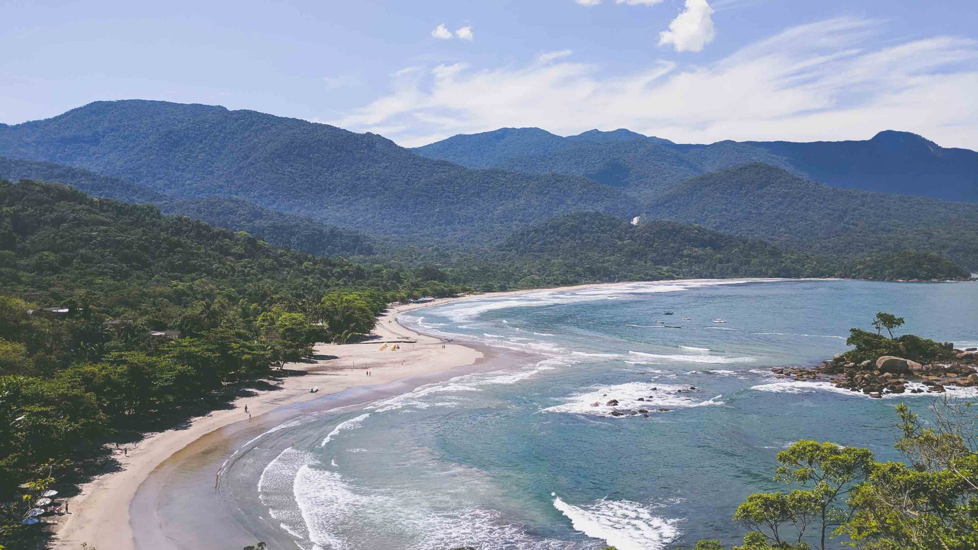 Sweeping views over Ilhabela reveal pristine coast and the biosphere reserve of the Atlantic rainforest.