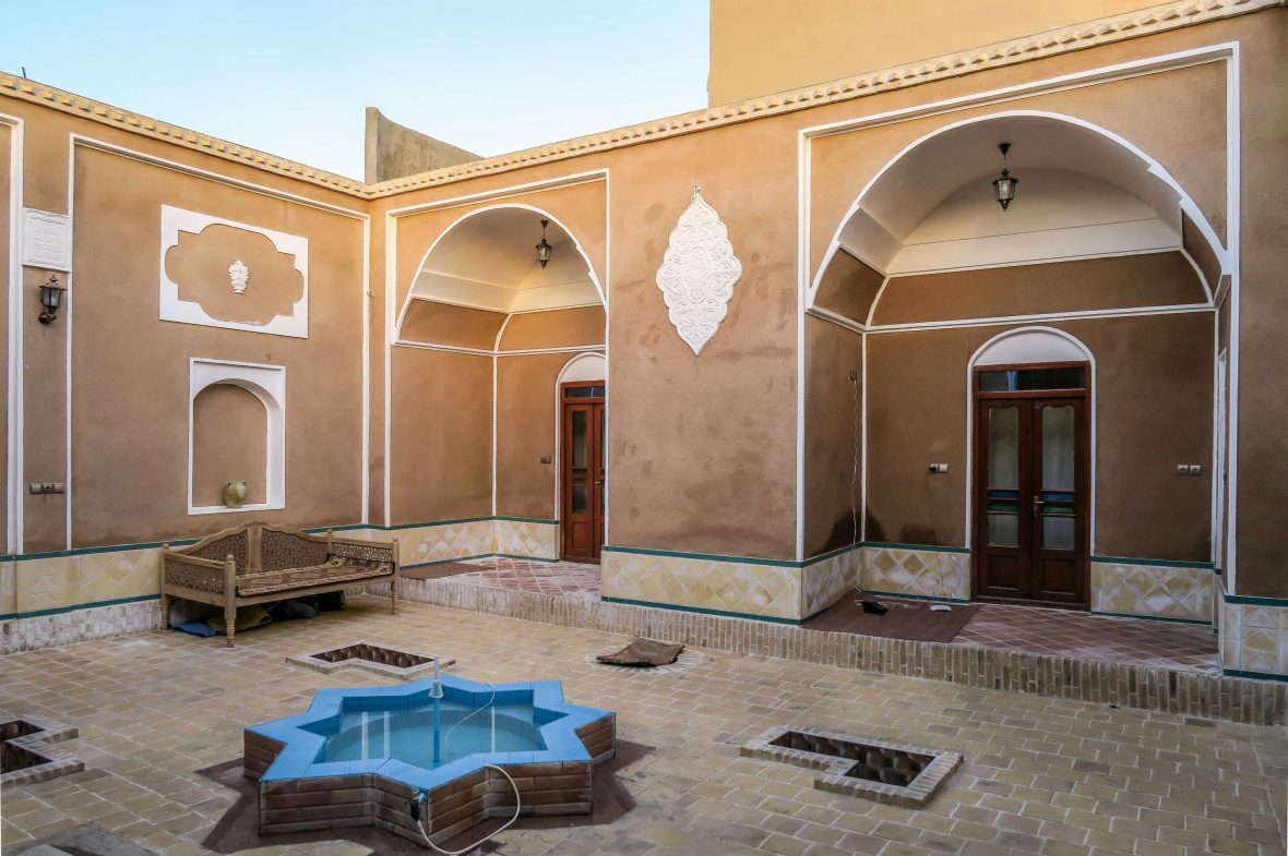 A star shaped fountain star-shaped marks the center of a traditional Iranian courtyard.