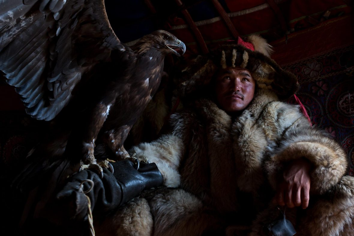 Shohan sits with the eagle he uses for hunting.
