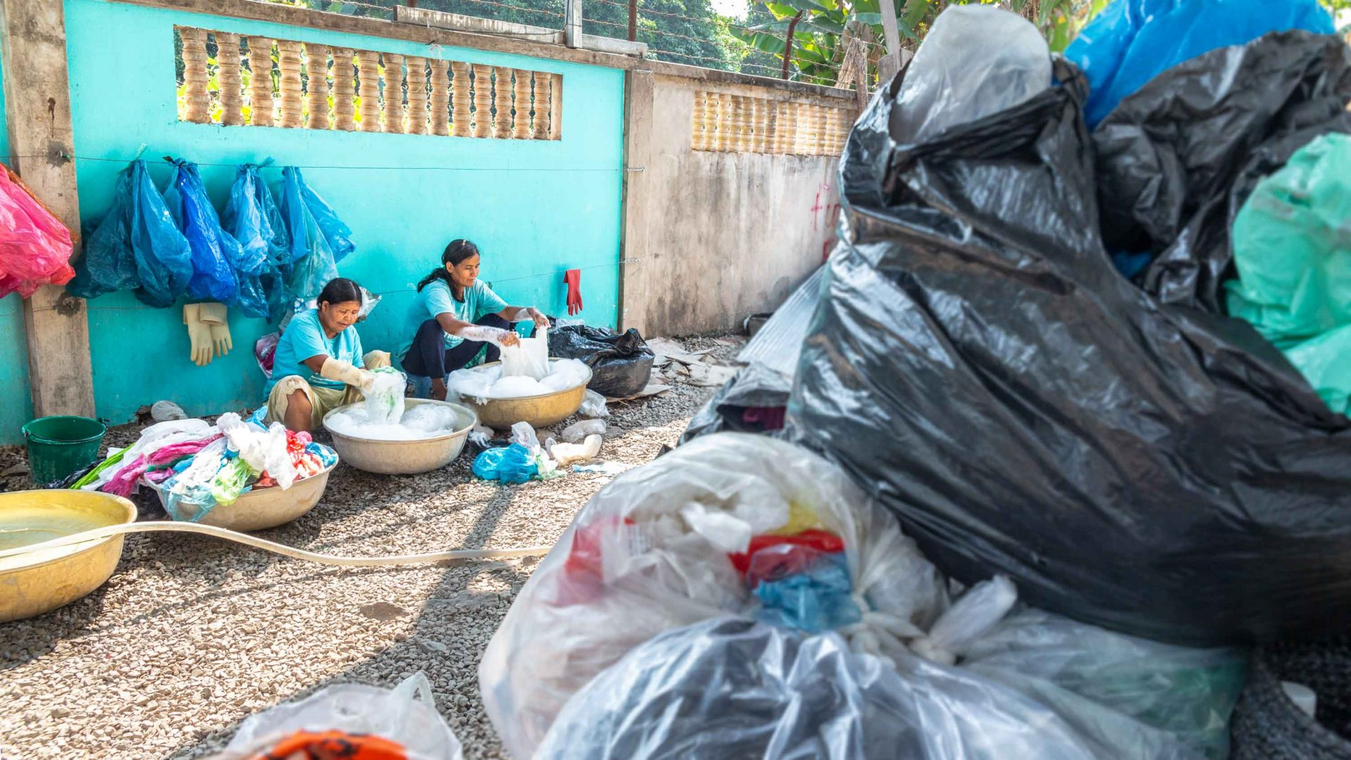Women work at the Cambodian organisation Rehash Trash which helps women escape the cycle of poverty while simultaneously clearing the streets of trash.
