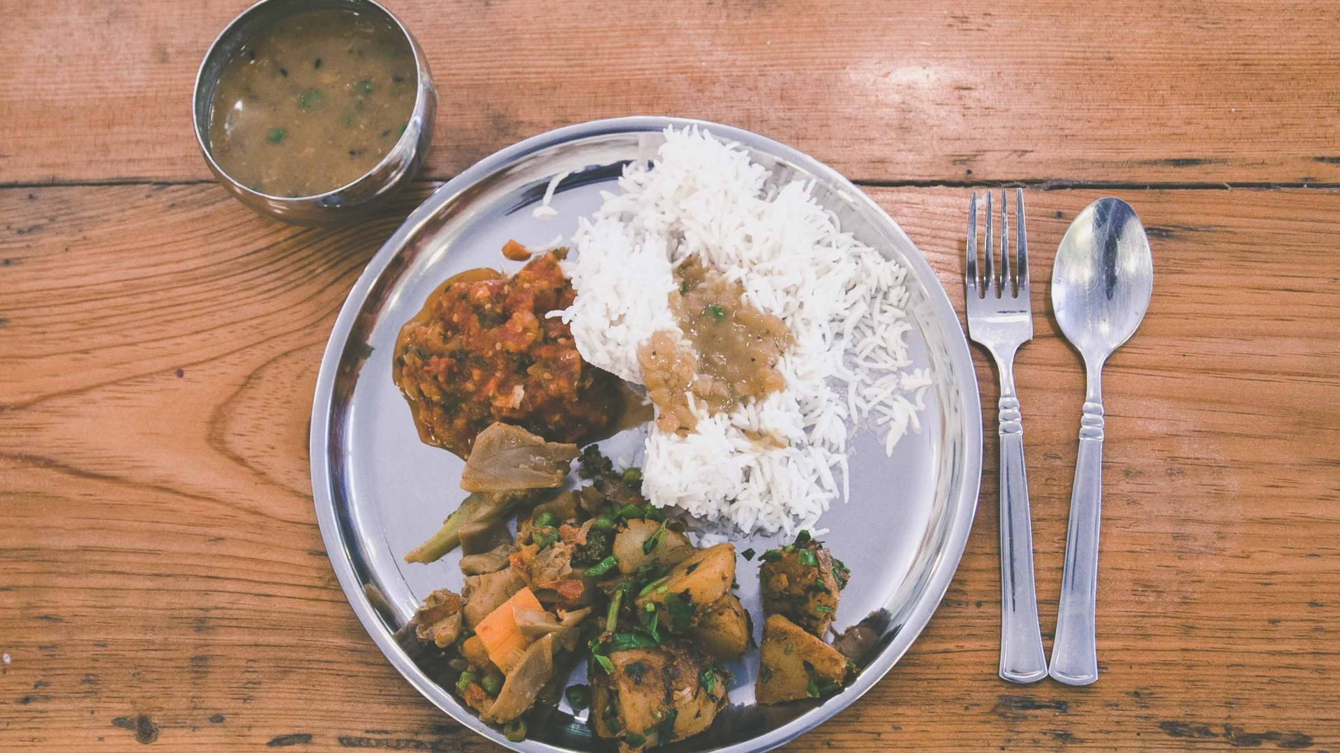 Dal Bhat, a typical Nepalese dish is prepared at Seven Women in Nepal.