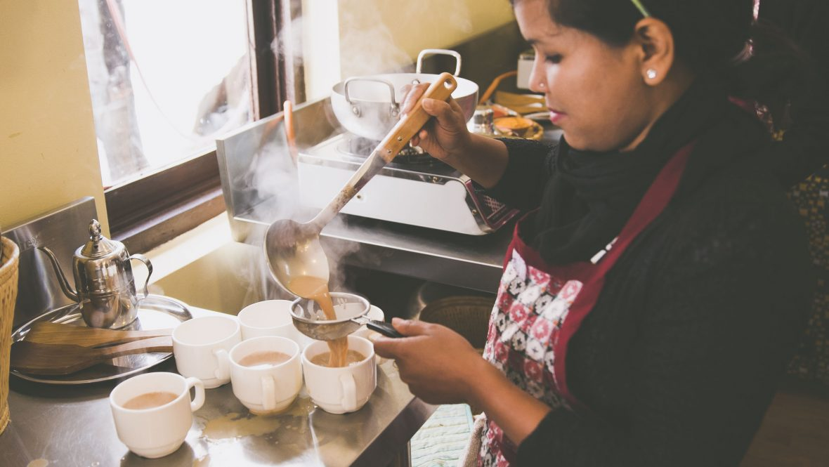 Preparing masala tea at Seven Women in Nepal.