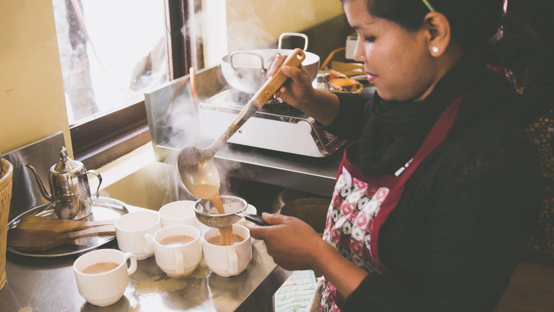 Preparing masala tea at Seven Women in Nepal.