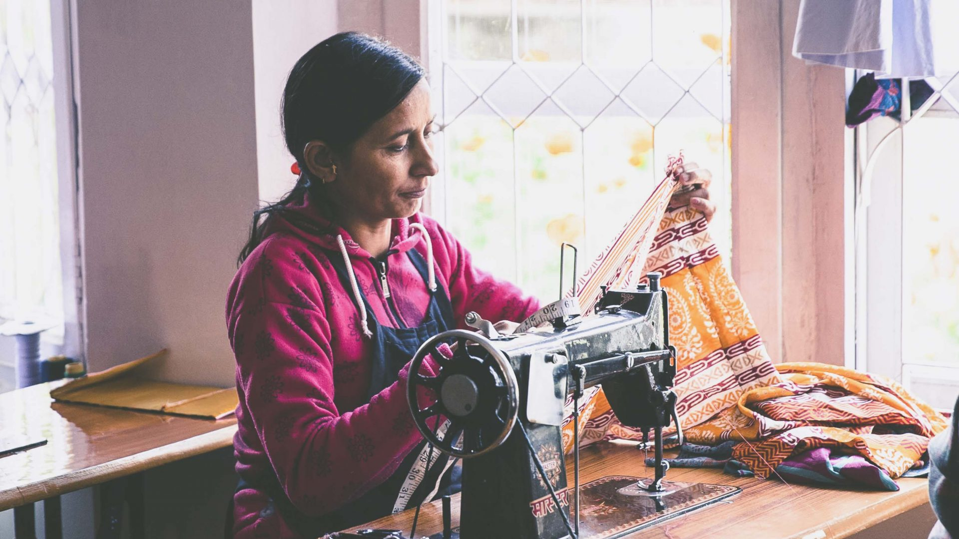 Women sewing at the Seven Women social enterprise in Nepal.