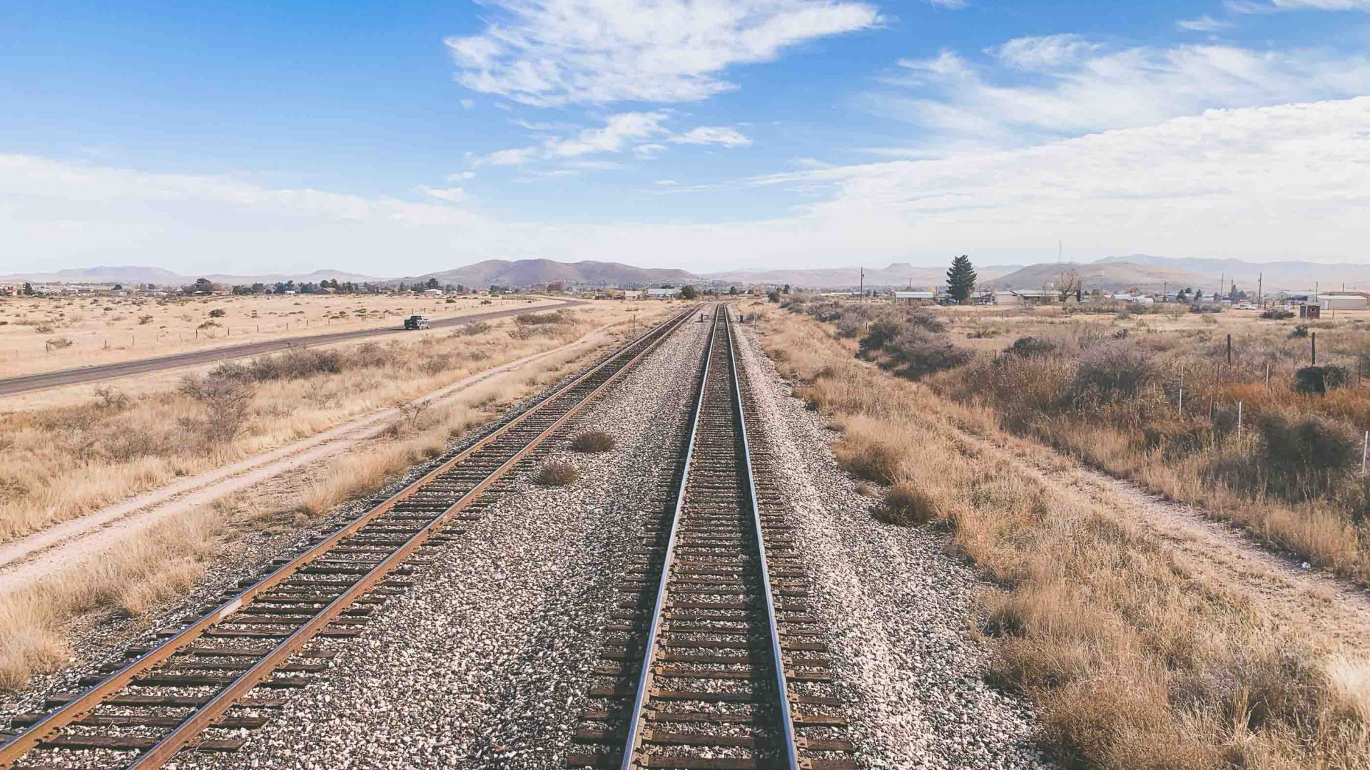 Train tracks head east over the desert in Texas.