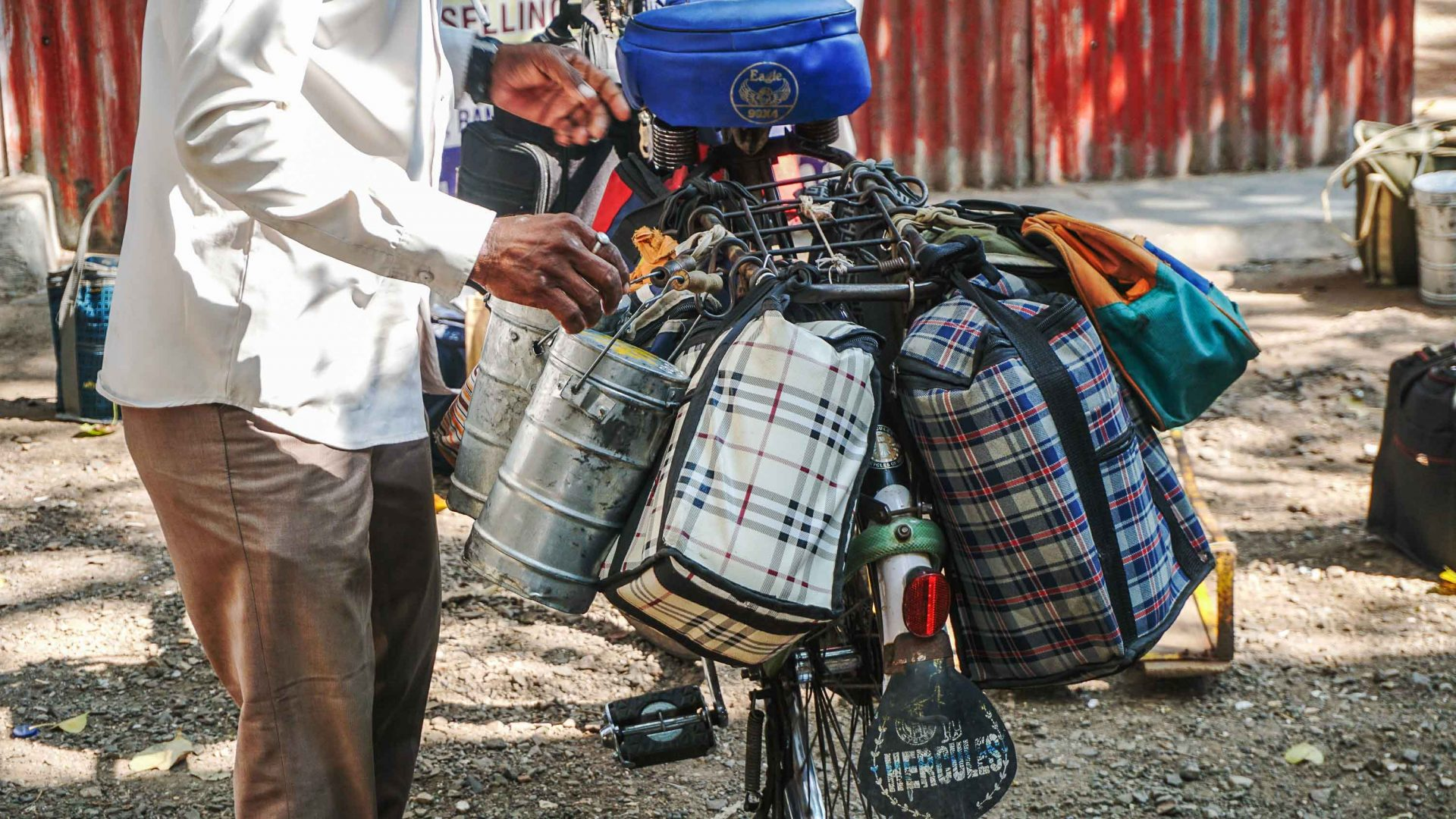 A dabbawala returns from his collections.