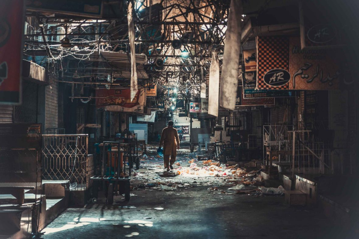 A man walks through a dilapidated market in Faisalabad, Pakistan.