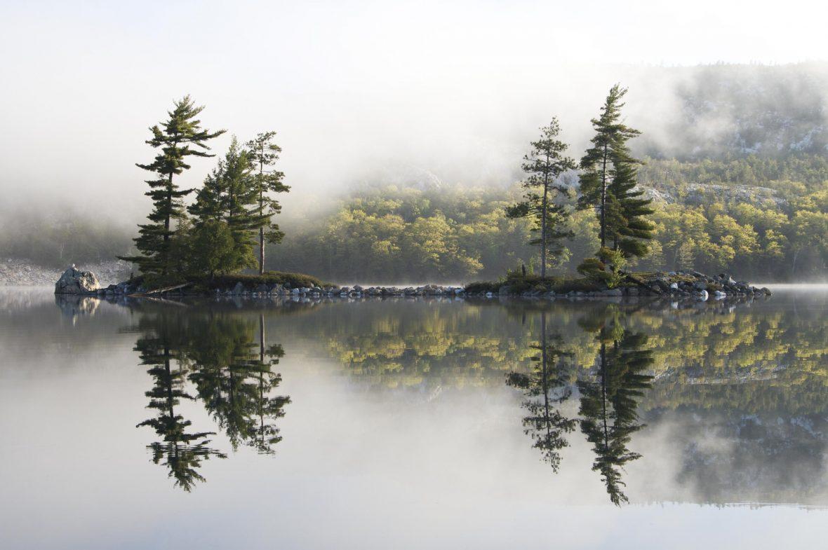 Stunning reflections at the still O.S.A Lake, Killarney, Canada.