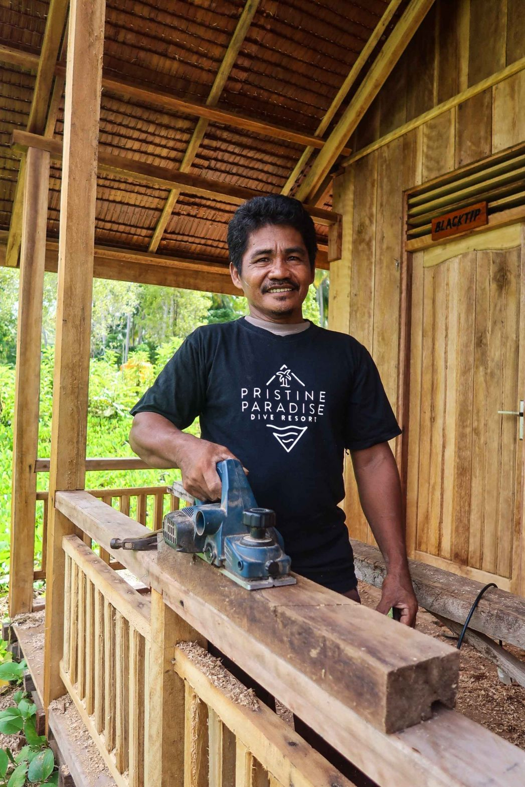 Papa Opi, who was 17 at the time that Mount Colo erupted, has returned to the island and now works as a carpenter at a local dive resort.