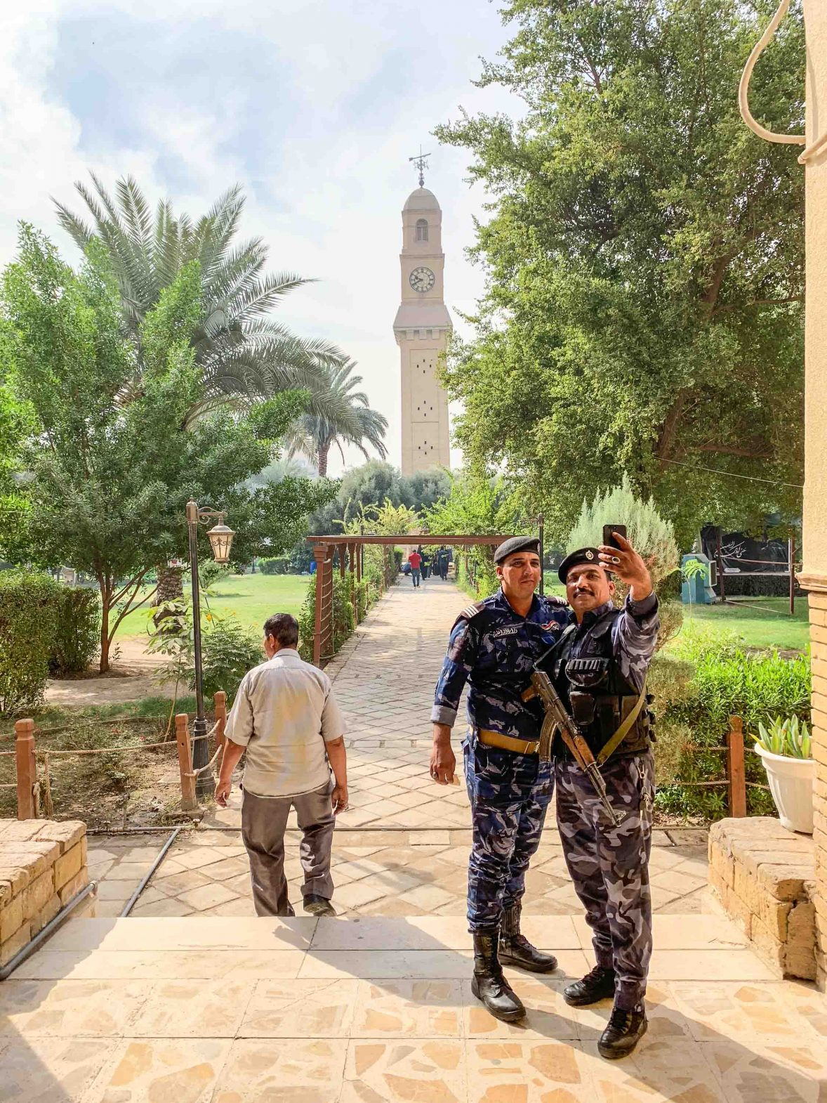 Police take a selfie in front of the Ottoman Clock in the Qishleh area of Iraq.