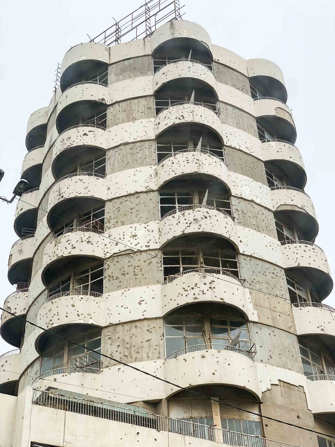 Bullet holes riddle a building in Baghdad, reminding visitors of its turbulent past.