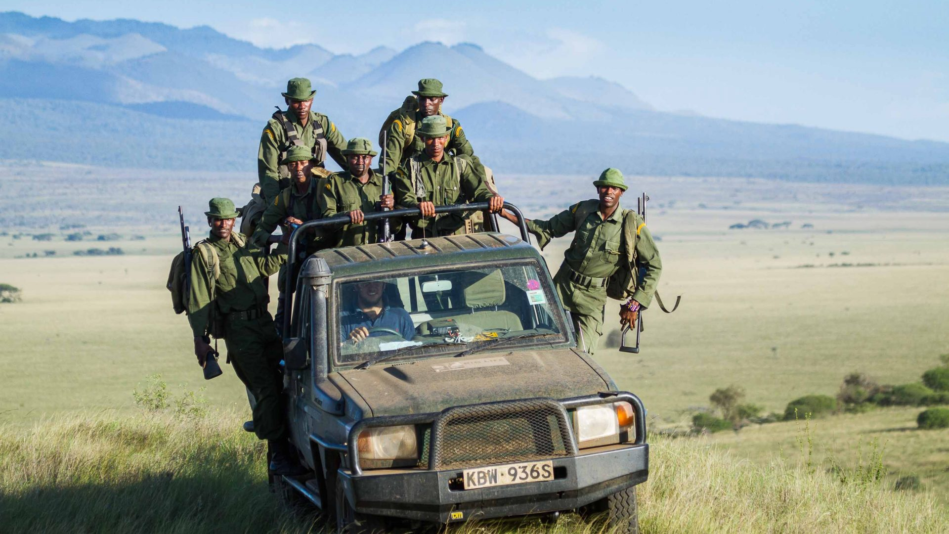 Rangers cross the plains in Kenya where they work.