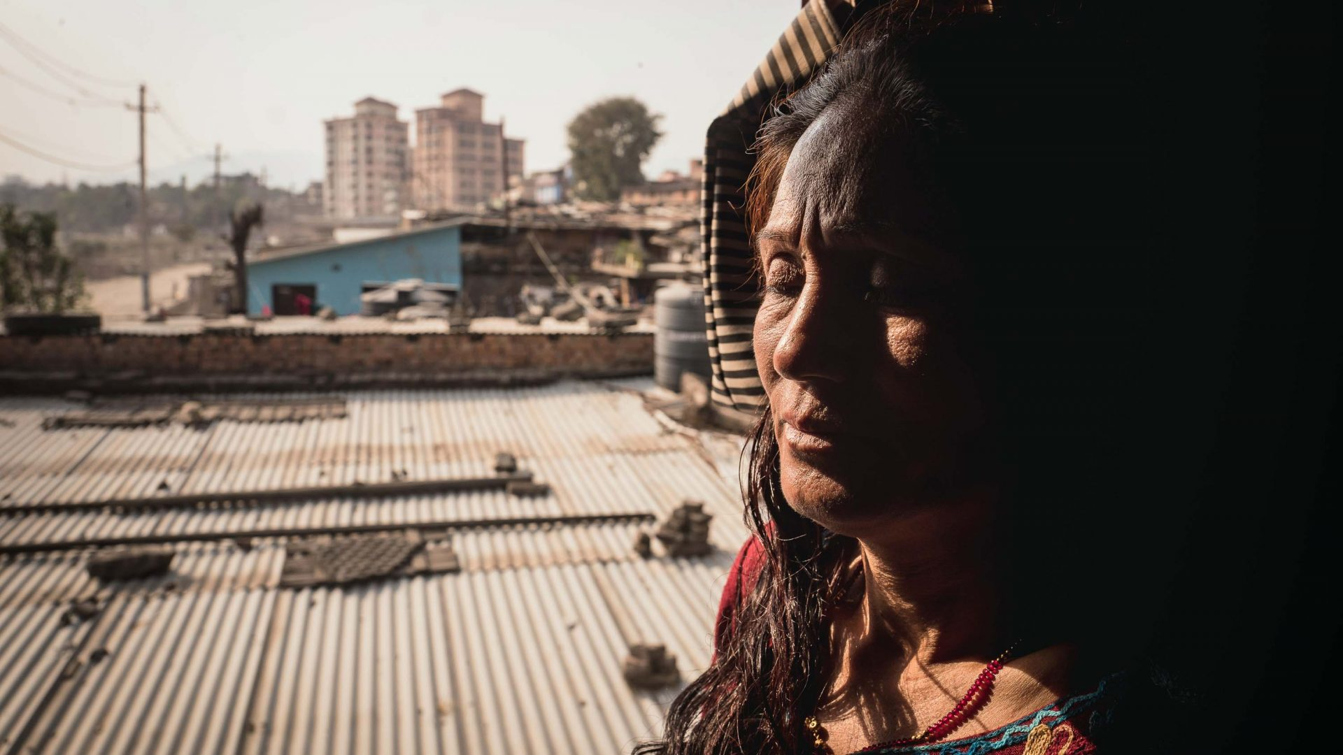 Sunita Thapa is 45 years old. Her husband was violent and beated her repeatedly before leaving her alone with two sons and two daughters. He disappeared and she has never heard from him again. At that point, without any resources, she moved to Banshighat, an settlement in Kathmandu.