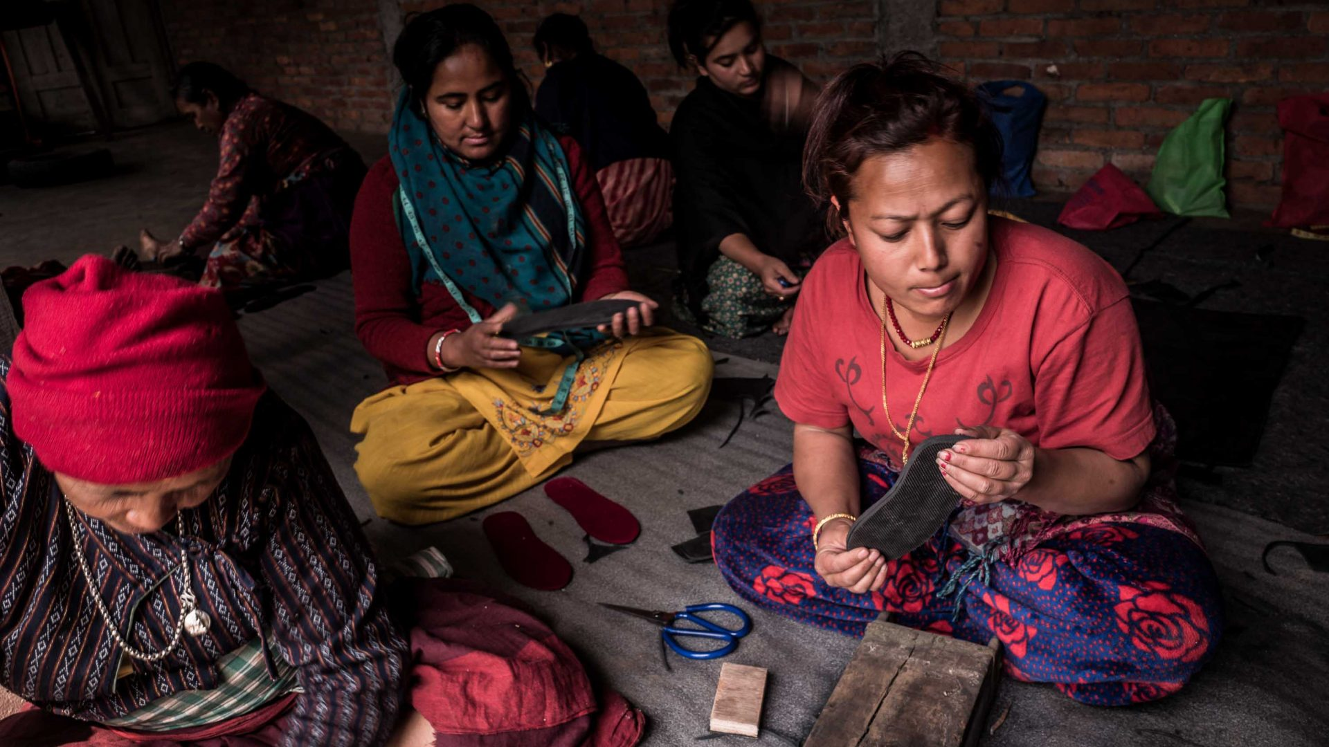 Tami Maja Maharjan and other women take part in shoe-making training designed by to help local widows acquire independence, in the Newari village of Sunakoti, Kathmandu valley.