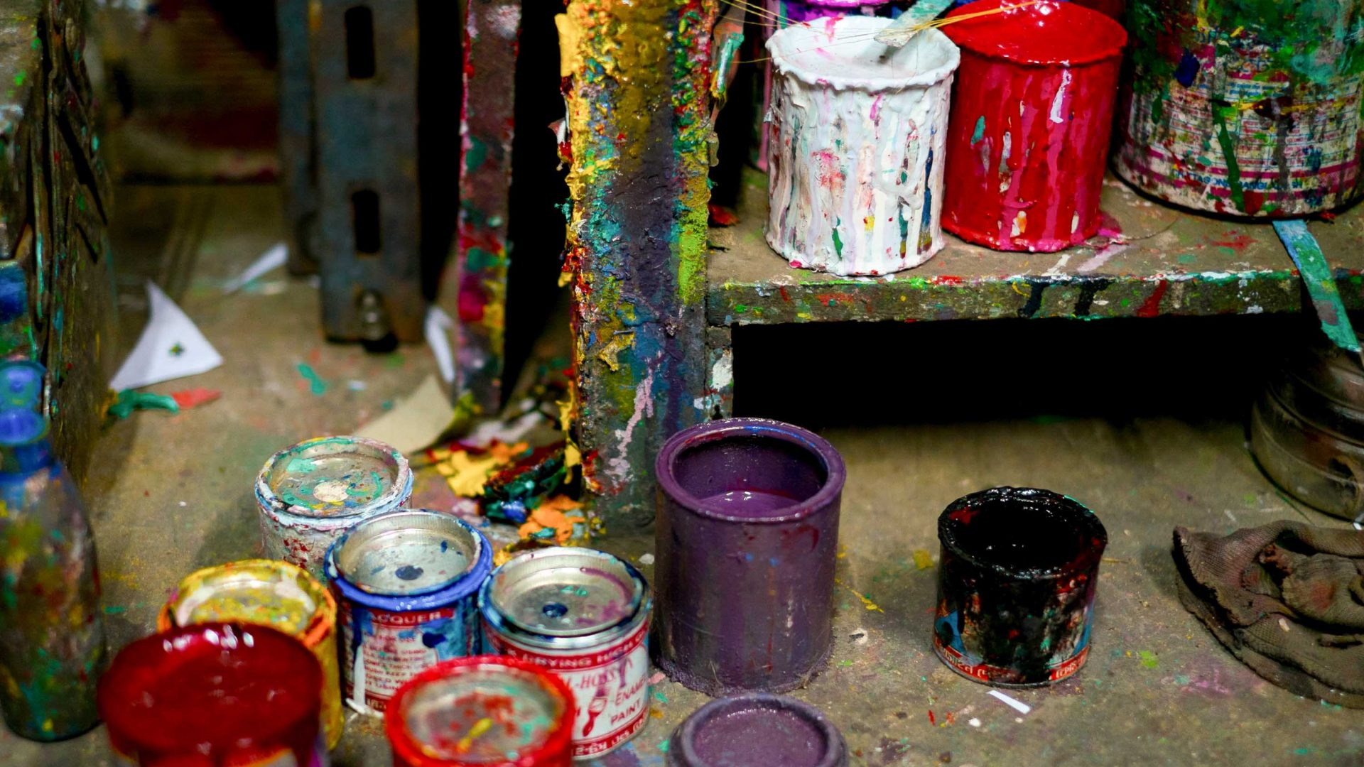 Paints and pots—an artist's arsenal at a workshop in Chittagong.