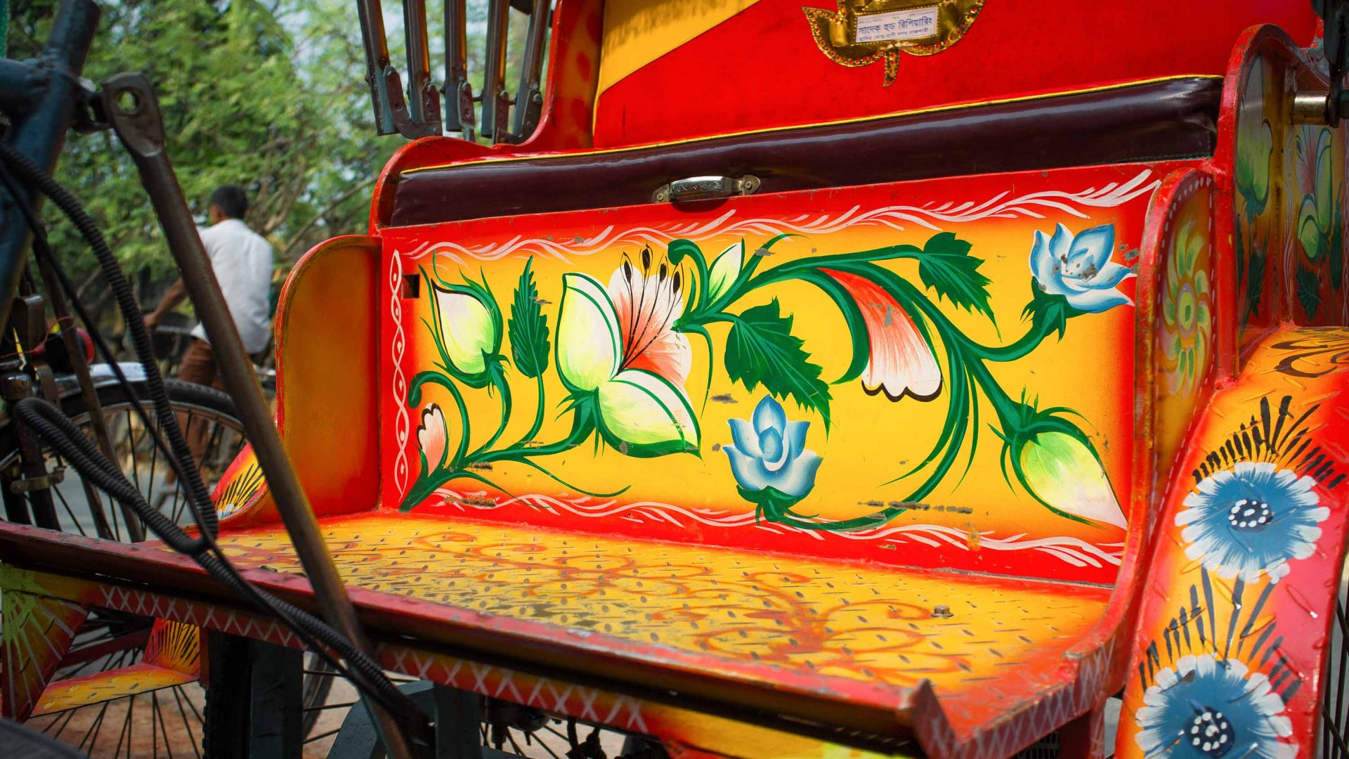 A rickshaw adorned with flowers.