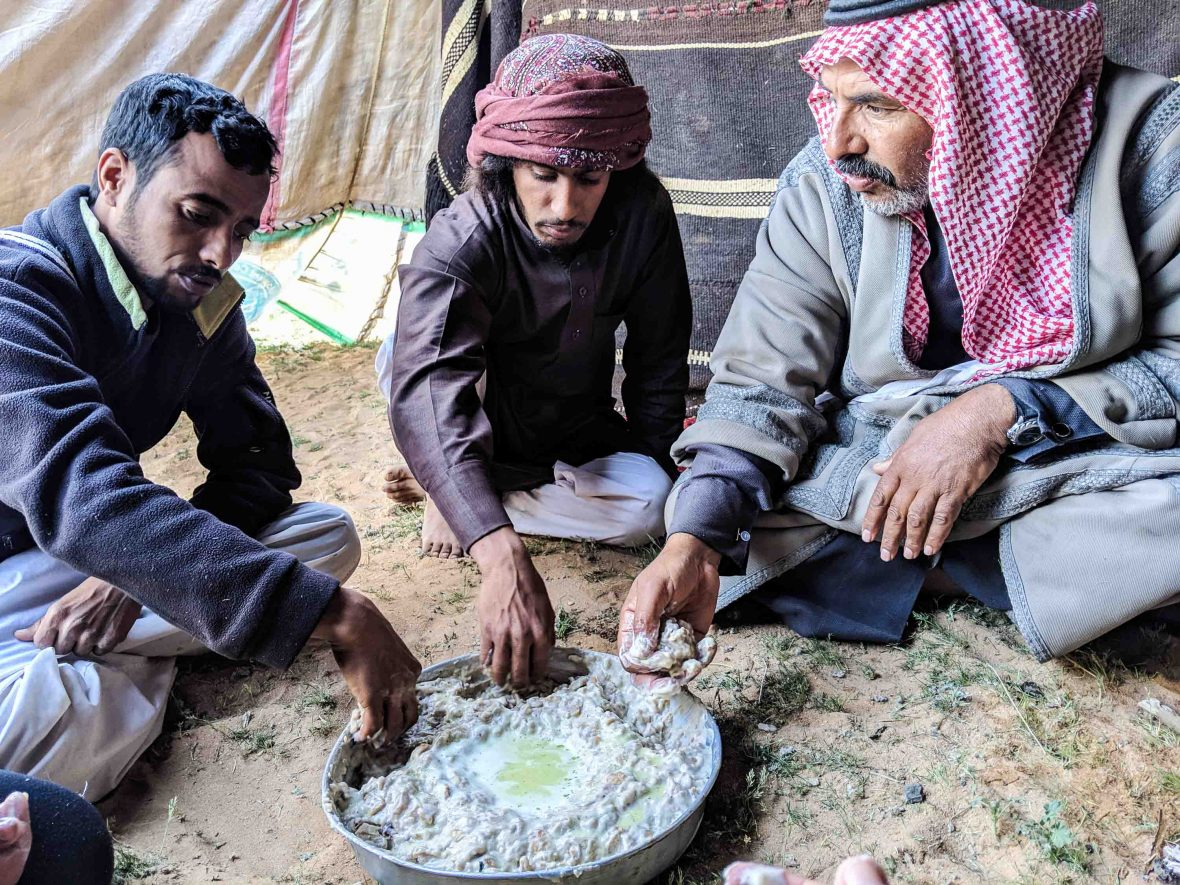 Abdullah's family gather to eat fatteh—a Bedouin dish made from bread, goat's yogurt and desert herb.