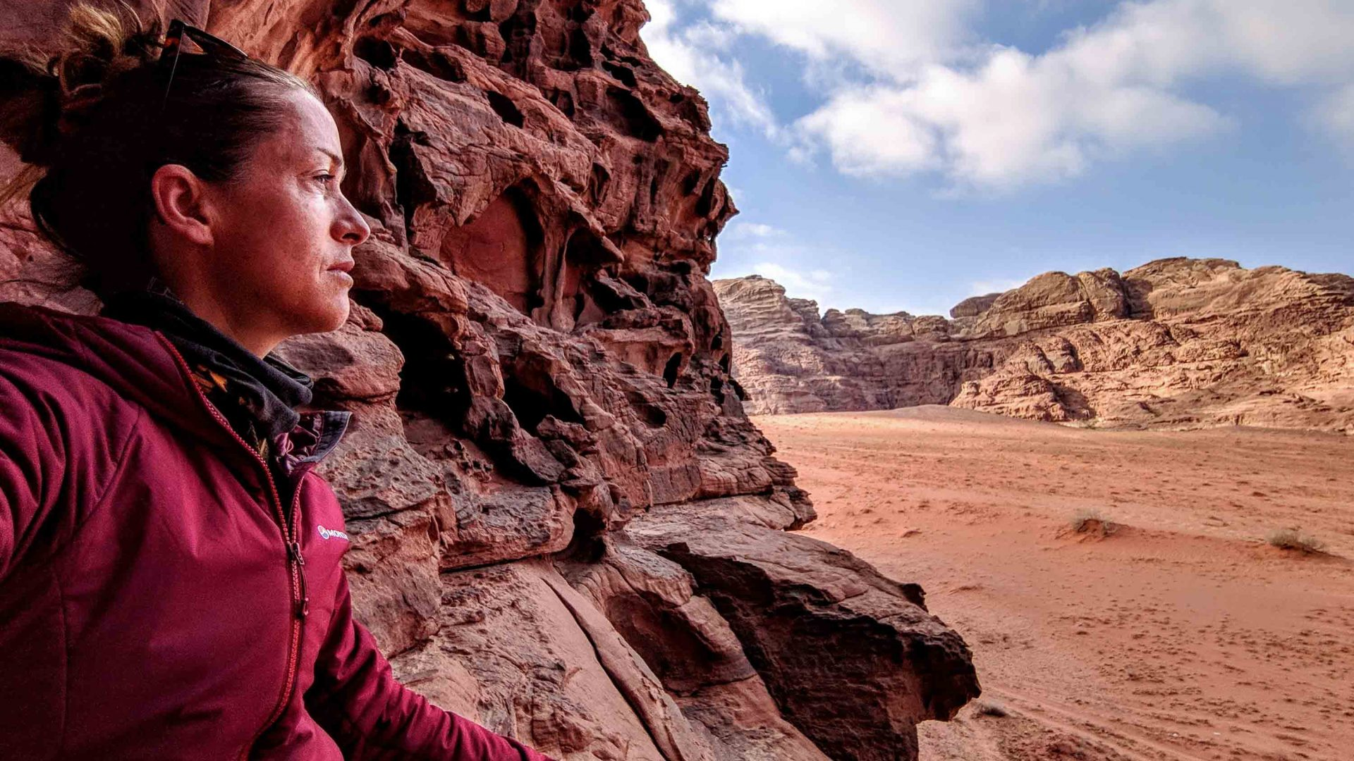 Writer Antonia looks out at the incredible desert views beneath her during her climb in Wadi Rum.