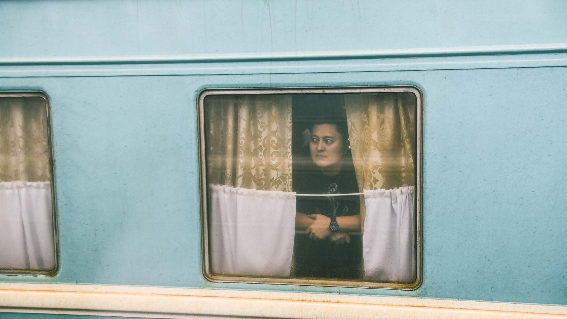 Writer Monisha Rajesh photographs a fellow passenger in Almaty, Kazakhstan.
