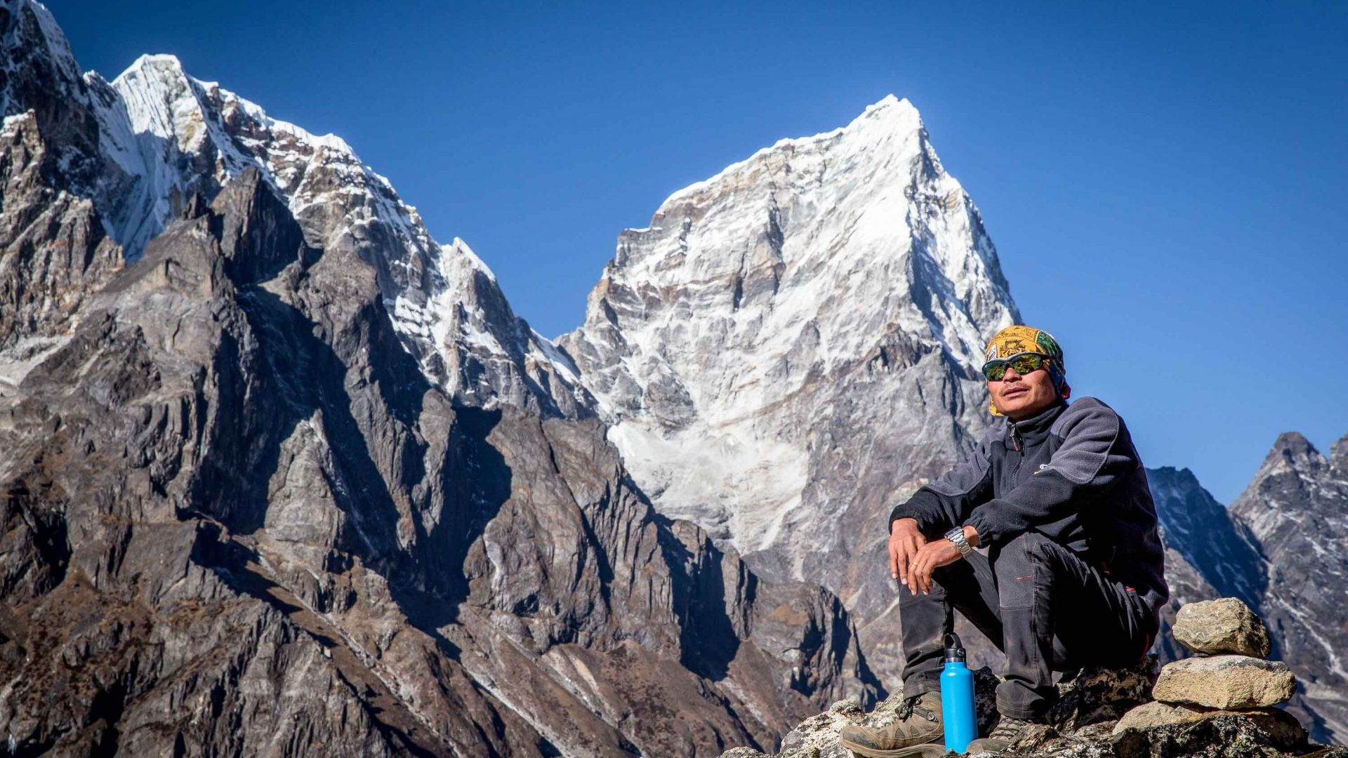 A porter relaxes and enjoys the view during the Everest Base Camp trek.