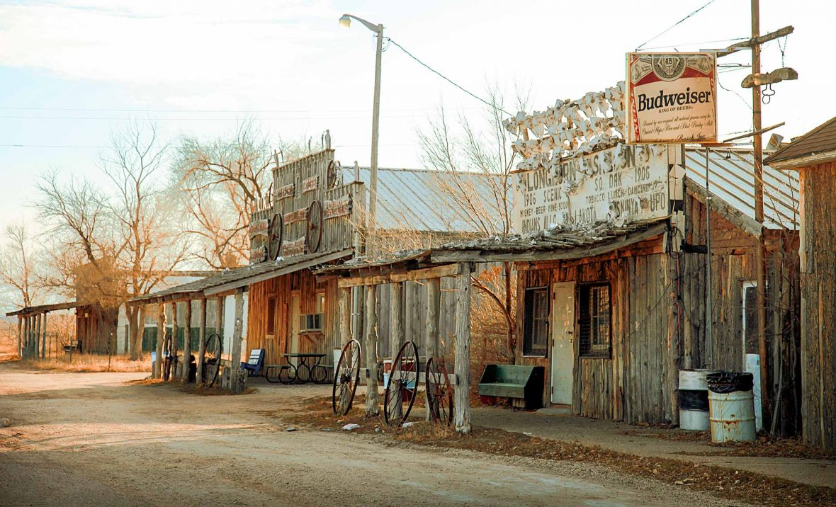 The Longhorn Saloon and other old buildings line the main street of Scenic, South Dakota.