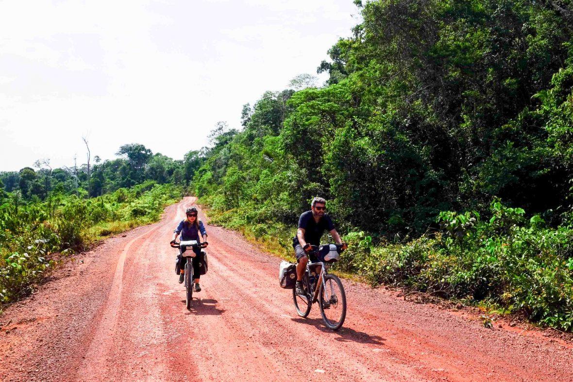 Reza Pakravan and Pip Stewart cycle along the Trans-Amazonian Highway.
