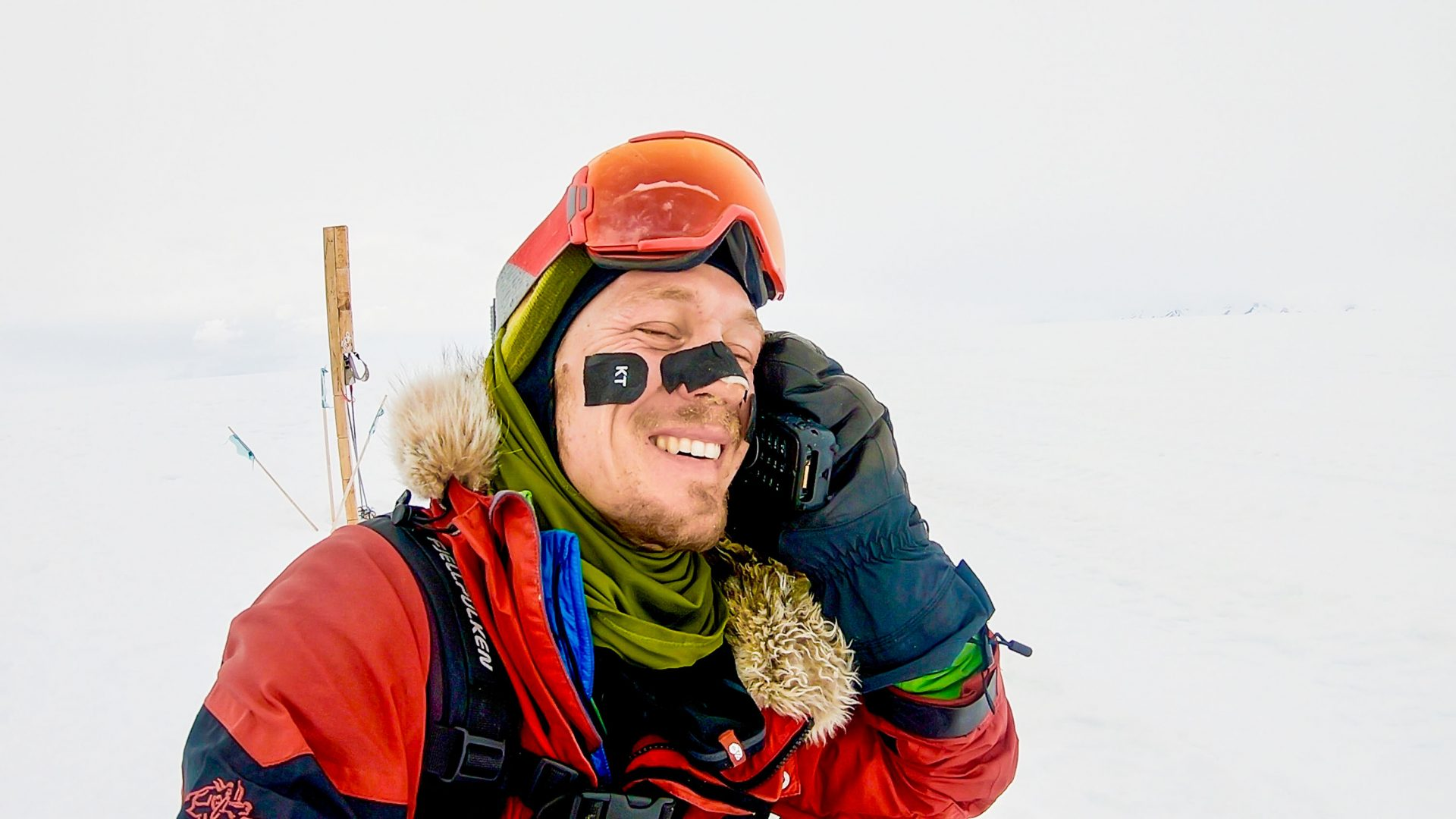 A relieved looking Colin on the phone upon completing his epic unsupported journey through Antarctica.